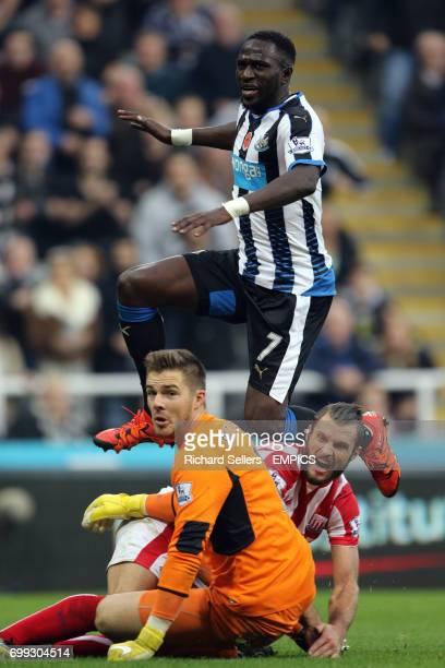 Newcastle United's Moussa Sissoko has his shot blocked by Stoke City's Erik Pieters and Stoke City goalkeeper Jack Butland