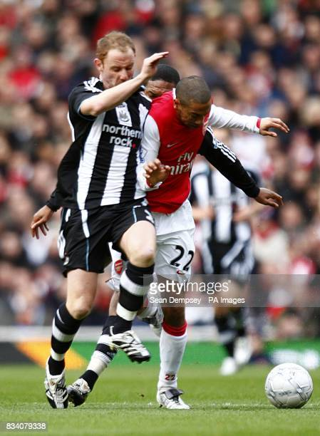 Newcastle United's Nicky Butt and Arsenal's Gael Clichy battle for the ball