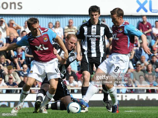Newcastle United's Nicky Butt tries to win the ball off West Ham United's Mark Noble and Scott Parker