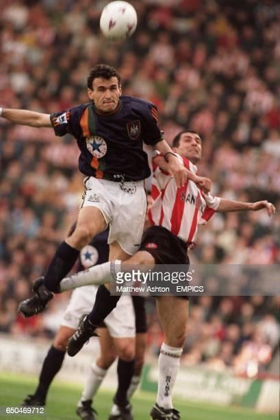 Newcastle United's Nikolaos Dabizas gets above Southampton's Francis Benali to head the ball