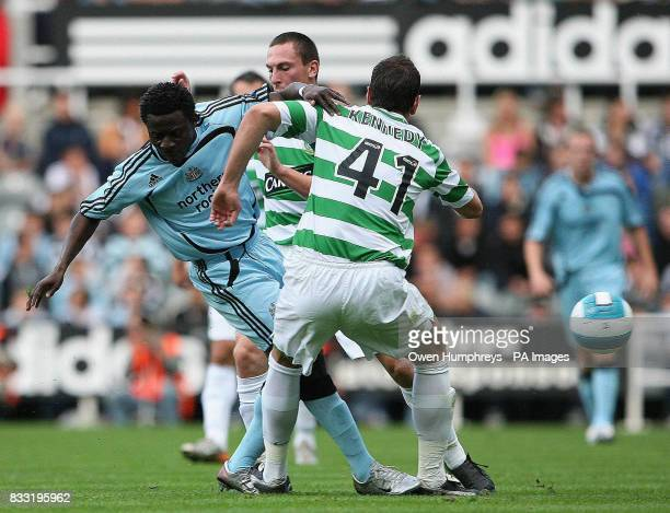 Newcastle United's Obafemi Martins tussles with Celtic's John Kennedy during the preseason friendly match at St James' Park Newcastle