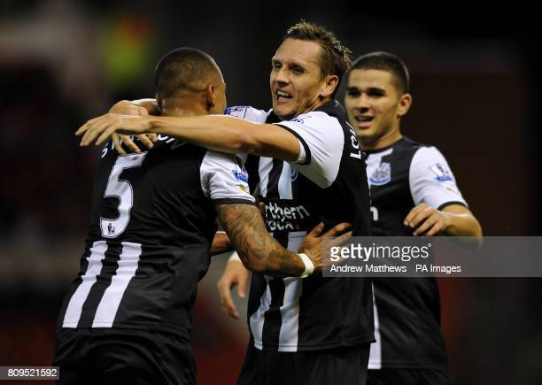 Newcastle United's Peter Lovenkrands celebrates scoring the opening goal with team mates Danny Simpson and Mehdi Abeid during the Carling Cup Third...