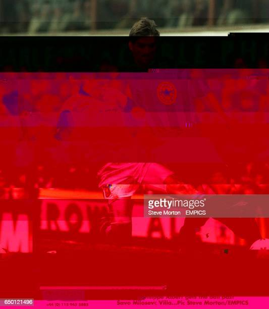 Newcastle United's Philippe Albert gets the ball past Savo Milosevic Aston Villa
