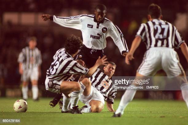 Newcastle United's Philippe Albert looks on as teammates Alessandro Pistone and Rob Lee combine to tackle Derby County's Paulo Wanchope