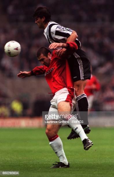 Newcastle United's Philippe Albert outjumps Eric Cantona Manchester United