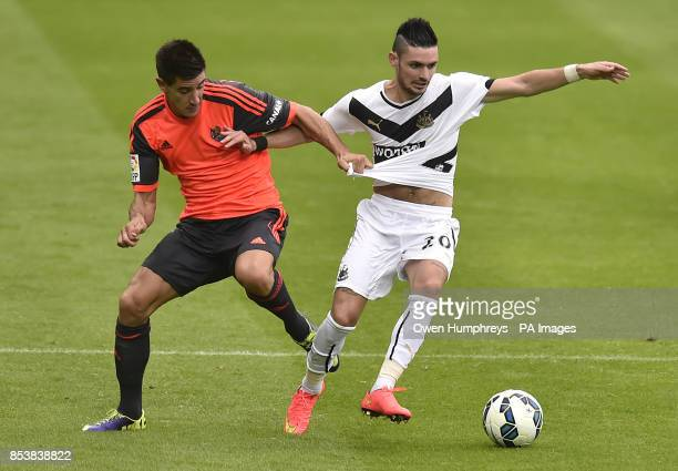 Newcastle United's Remy Cabella and Real Sociedad's Yuri Berchiche during the PreSeason friendly match at St James' Park Newcastle
