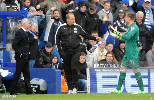 Newcastle United's Robert Elliot walks past his manager Alan Pardew and goal keeping coach Andy Woodman after being shown a red card during the...