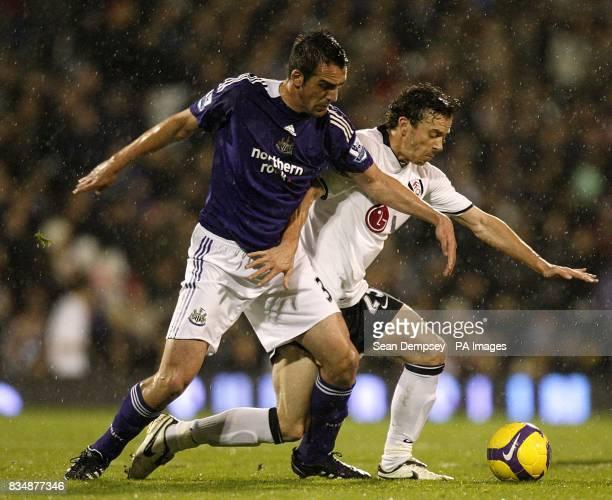Newcastle United's Sanchez Jose Enrique and Fulham's Simon Davies battle for the ball