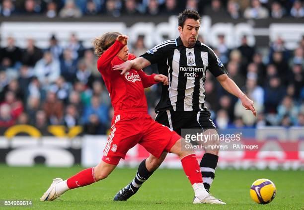 Newcastle United's Sanchez Jose Enrique and Liverpool's Leiva Lucas battle for the ball