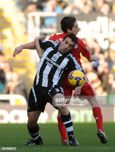 Newcastle United's Sanchez Jose Enrique and Liverpool's Yossi Benayoun battle for the ball