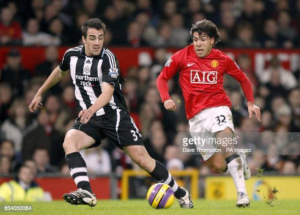 Newcastle United's Sanchez Jose Enrique and Manchester United's Carlos Tevez