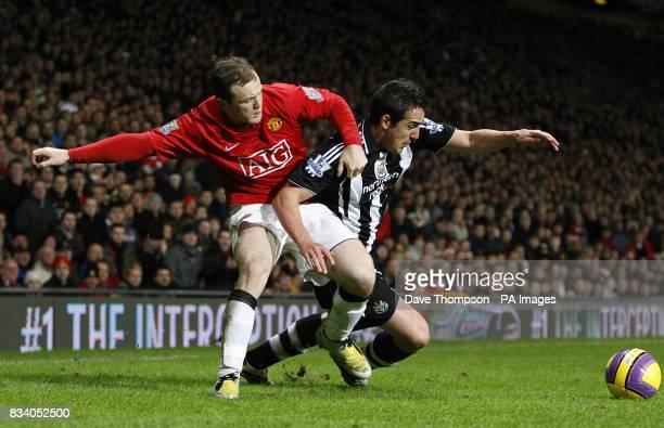 Newcastle United's Sanchez Jose Enrique and Manchester United's Wayne Rooney