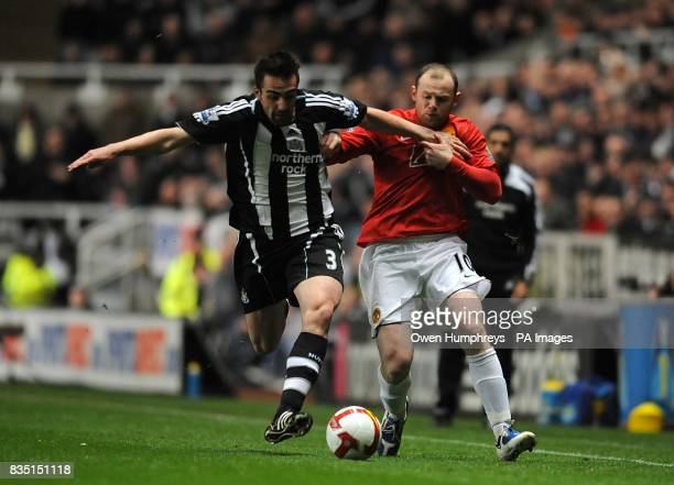 Newcastle United's Sanchez Jose Enrique and Manchester United's Wayne Rooney battle for the ball