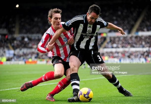 Newcastle United's Sanchez Jose Enrique and Sunderland's Dean Whitehead battle for the ball