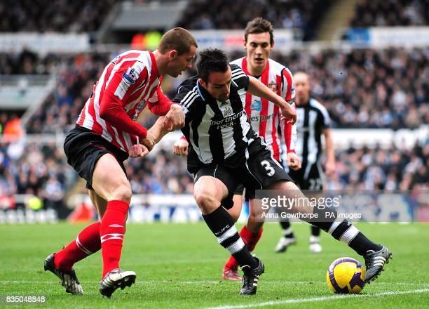 Newcastle United's Sanchez Jose Enrique and Sunderland's Phillip Bardsley battle for the ball