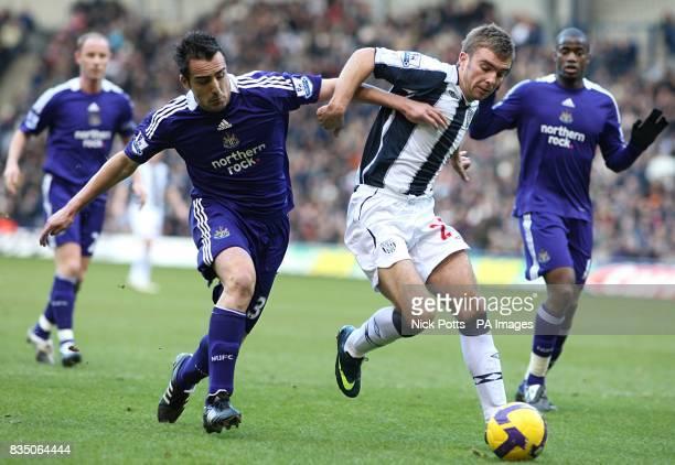 Newcastle United's Sanchez Jose Enrique and West Bromwich Albion's James Morrison battle for the ball