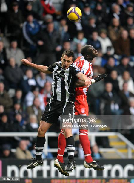 Newcastle United's Sanchez Jose Enrique jumps high with Stoke City's Mamady Sidibe Stoke City in a battle for the ball