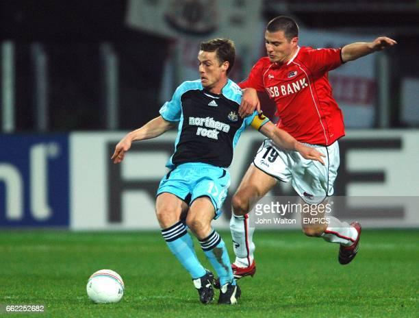 Newcastle United's Scott Parker and AZ Alkmaar's Danny Koevermans battle for the ball