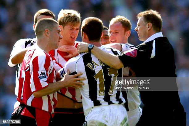 Newcastle United's Scott Parker and Sheffield United's Jonathan Stead have a tussle after a foul on Obafemi Martins