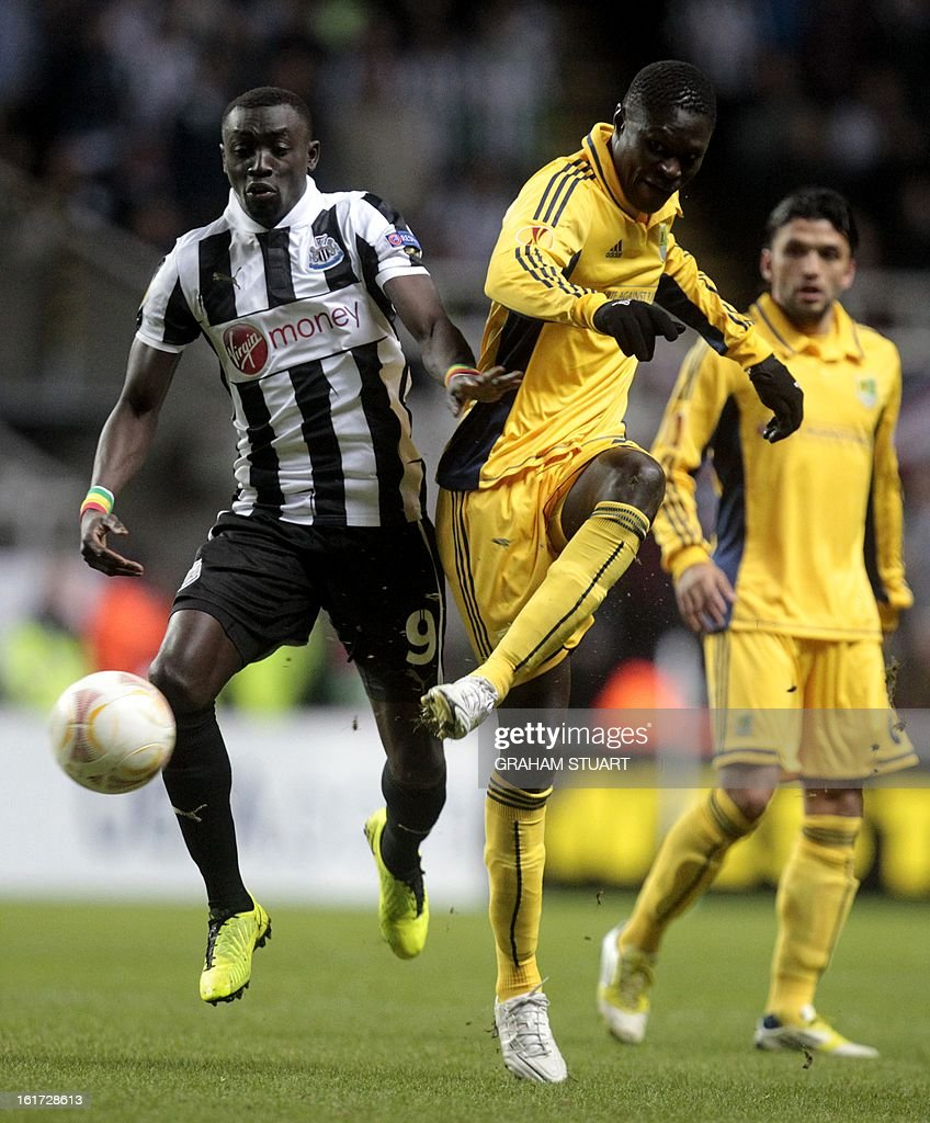 Newcastle United's Senegalese striker, Papiss Cisse (L) vies with Metalist Kharkiv's Senegalese defender, Papa Gueye (R) during the UEFA Europa League round of 32, first leg football match between Newcastle United and Metalist Kharkiv at St James Park, Newcastle-upon-Tyne, England, on February 14, 2013.