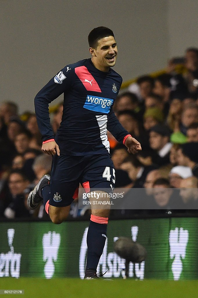 Newcastle United's Serbian striker Aleksandar Mitrovic celebrates scoring their first goal to eqaulise 1-1 during the English Premier League football match between Tottenham Hotspur and Newcastle United at White Hart Lane in north London on December 13, 2015. AFP PHOTO / BEN STANSALL USE. No use with unauthorized audio, video, data, fixture lists, club/league logos or 'live' services. Online in-match use limited to 75 images, no video emulation. No use in betting, games or single club/league/player publications. / AFP / BEN