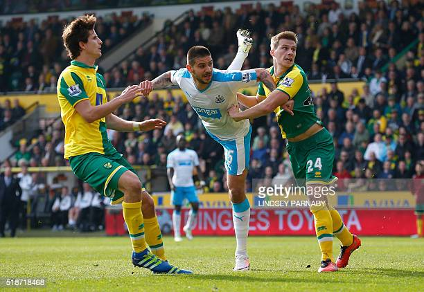 Newcastle Uniteds Serbian striker Aleksandar Mitrovic heads and scores during the English Premier League football match between Norwich City and...