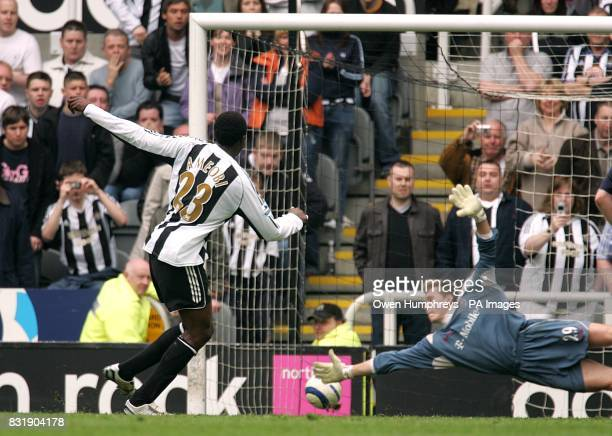 Newcastle United's Shola Ameobi puts the ball just past West Bromwich Albion keeper Tomasz Kuszczak from the penalty spot to score his teams second...