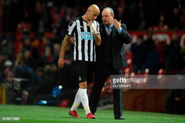 Newcastle United's Spanish manager Rafael Benitez talks with Newcastle United's English midfielder Jonjo Shelvey as they leave the pitch at the end...