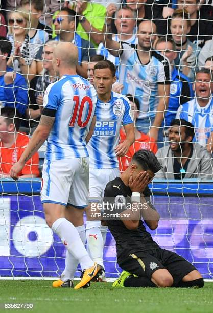 Newcastle United's Spanish striker Ayoze Perez reacts after missing a chance at goal during the English Premier League football match between...