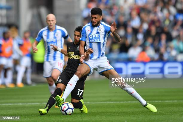 TOPSHOT Newcastle United's Spanish striker Ayoze Perez vies with Huddersfield Town's Danish midfielder Philip Billing during the English Premier...