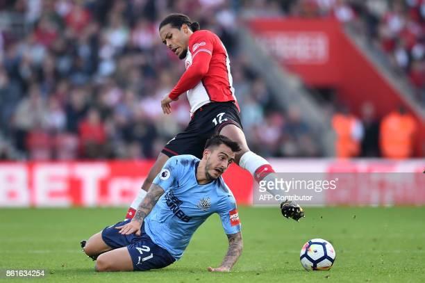 Newcastle United's Spanish striker Mato Joselu tangles with Southampton's Dutch defender Virgil van Dijk during the English Premier League football...