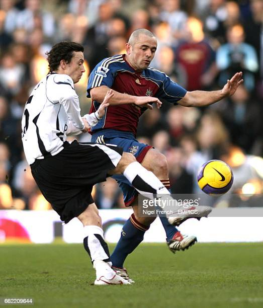 Newcastle United's Stephen Carr and Fulham's Simon Davies battle for the ball