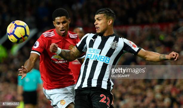 Newcastle United's US defender DeAndre Yedlin challenges Manchester United's English striker Marcus Rashford during the English Premier League...