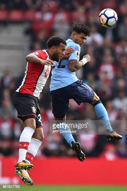 Newcastle United's US defender DeAndre Yedlin heads the ball ahead of Southampton's English defender Ryan Bertrand during the English Premier League...