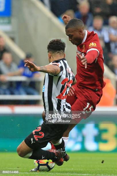 Newcastle United's US defender DeAndre Yedlin vies with Liverpool's English striker Daniel Sturridge during the English Premier League football match...