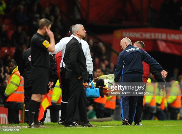 Newcastle United's Vurnon Anita is carried off the pitch on a stretcher