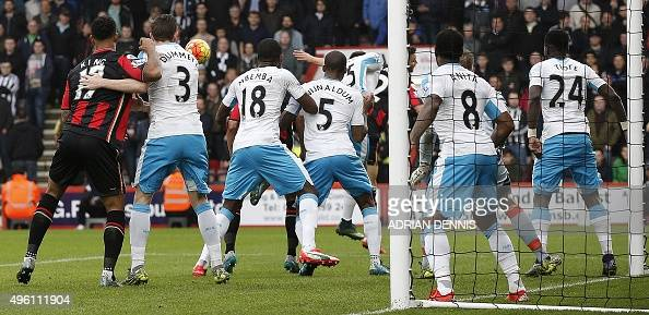 Newcastle United's Welsh defender Paul Dummett tussles with Bournemouth's Norwegian striker Joshua King as his teammates block the goalmouth during a...