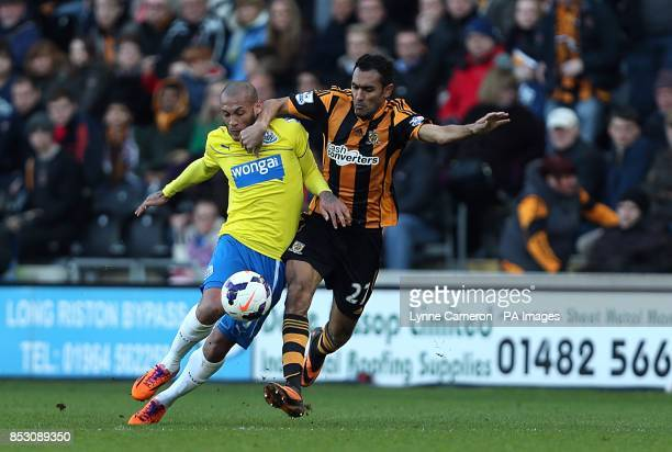 Newcastle United's Yoan Gouffran and Hull City's Ahmed Elmohamady battle for the ball