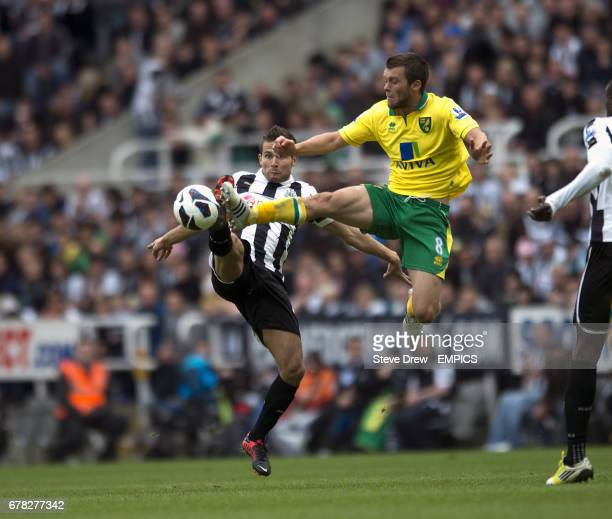 Newcastle United's Yohan Cabaye and Norwich City's Jonny Howson battle for the ball