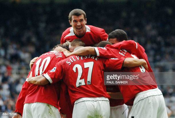 Manchester United's captaian Roy Keane dives over as the team celebrates Ruud van Nistelrooy's goal against Newcastle United during their...