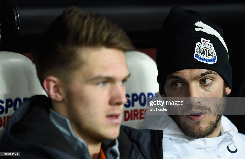 Newcastle's 17 year old substitute goalkeeper Freddie Woodman chats with fellow sub Davide Santon before the Barclays Premier League match between...