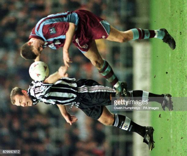 Newcastle's Alan Shearer battles with Tranmere's Clint Hill during their FA Cup Fifth Round clash at St James' Park today Newcastle went on to take...