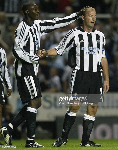 Newcastles Alan Shearer is concratulated by team mate Shola Ameobi after scoring his second against Bayern Munich during their preseason friendly at...