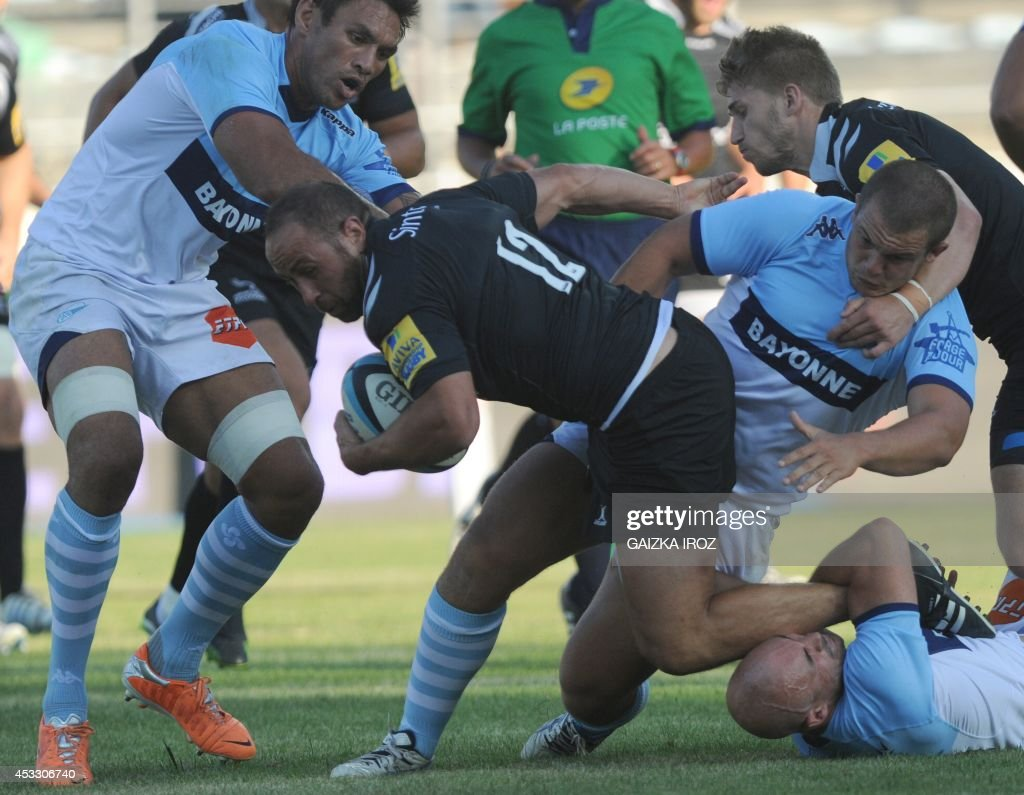 Newcastle's center Jamie Helleur is tackled by Bayonne's flyhalf Blair Stewart during the friendly rugby match between Bayonne and Newcastle on...