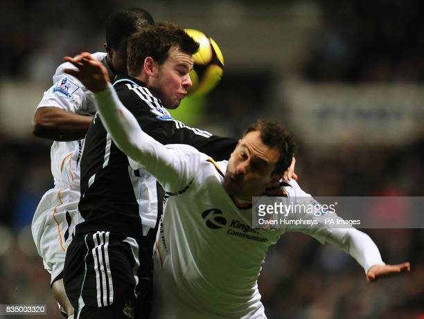 Newcastle's Danny Guthrie and Hull's Richard Garcia battle for the ball during the FA Cup Third Round Replay at St James' Park Newcastle