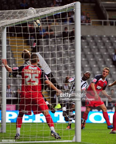 Newcastle's Geremi has a shot tipped over by Huddersfield goalkeeper Alex Smithies during the Carling Cup Second Round match at St James' Park...