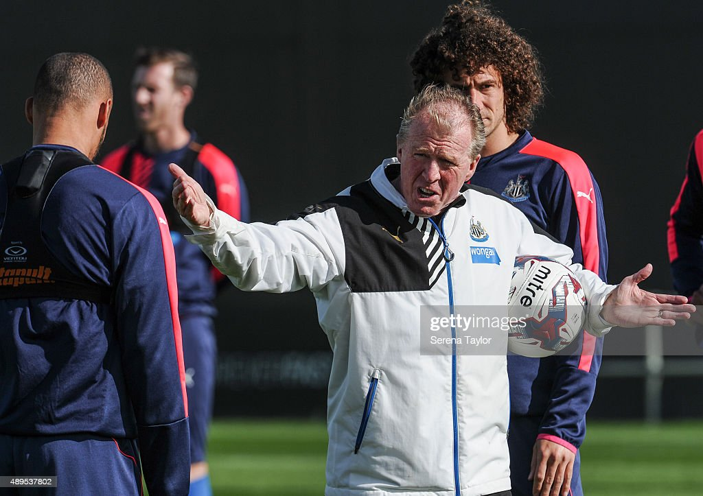 Newcastle's Head Coach <a gi-track='captionPersonalityLinkClicked' href=/galleries/search?phrase=Steve+McClaren+-+Soccer+Manager&family=editorial&specificpeople=210864 ng-click='$event.stopPropagation()'>Steve McClaren</a> (C) holds a ball under arm whilst pointing his hands and speaking to <a gi-track='captionPersonalityLinkClicked' href=/galleries/search?phrase=Yoan+Gouffran&family=editorial&specificpeople=534470 ng-click='$event.stopPropagation()'>Yoan Gouffran</a> (L) during a Newcastle United Training session at The Newcastle United Training Centre on September 22, 2015, in Newcastle upon Tyne, England.