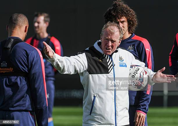 Newcastle's Head Coach Steve McClaren holds a ball under arm whilst pointing his hands and speaking to Yoan Gouffran during a Newcastle United...