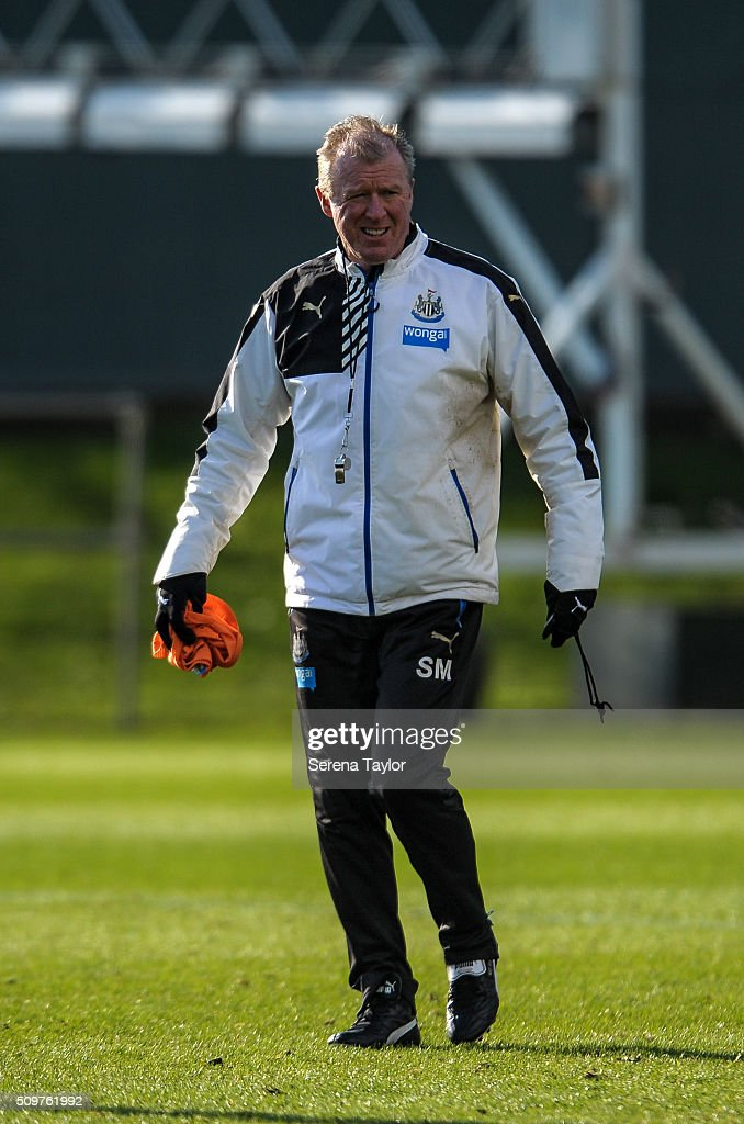 Newcastle's Head Coach <a gi-track='captionPersonalityLinkClicked' href=/galleries/search?phrase=Steve+McClaren+-+Soccer+Manager&family=editorial&specificpeople=210864 ng-click='$event.stopPropagation()'>Steve McClaren</a> (C) smiles whilst walking on the pitch during the Newcastle United Training session at The Newcastle United Training Centre on February 12, 2016, in Newcastle upon Tyne, England.