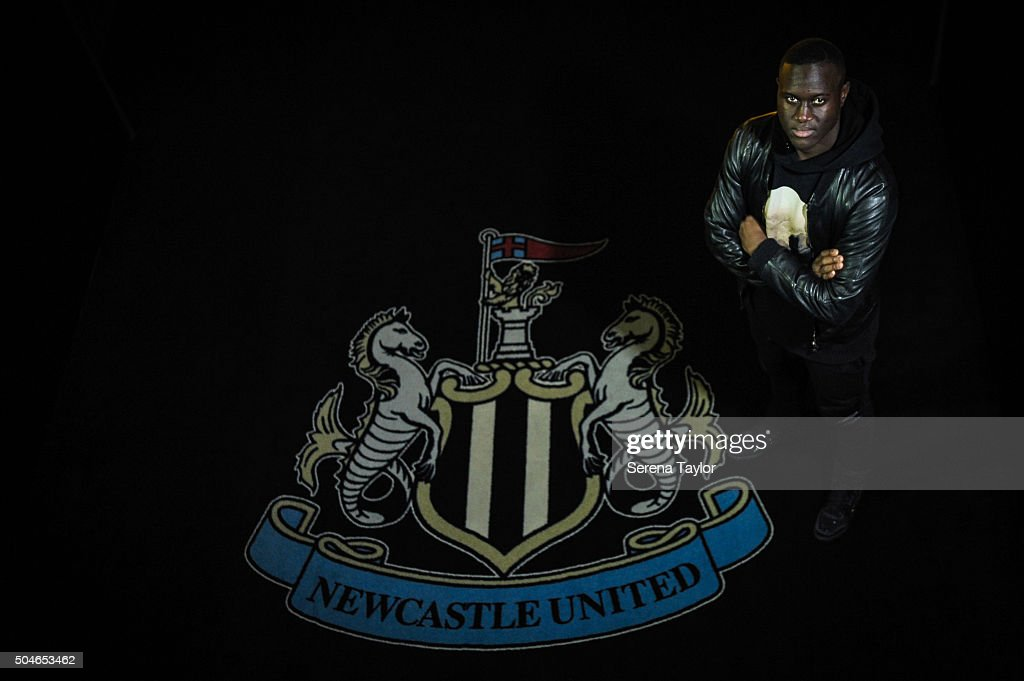 Newcastle's January signing <a gi-track='captionPersonalityLinkClicked' href=/galleries/search?phrase=Henri+Saivet&family=editorial&specificpeople=5969966 ng-click='$event.stopPropagation()'>Henri Saivet</a> poses for photographs in front of the club badge at St.James' Park on January 11, 2016, in Newcastle upon Tyne, England.